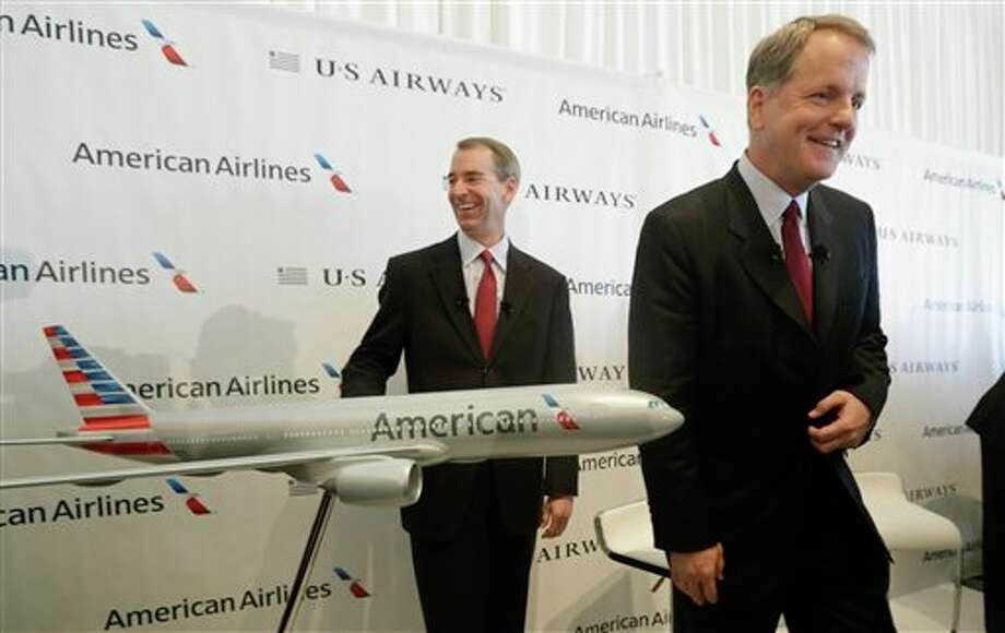 U.S. Airways CEO Doug Parker, right, and American Airlines CEO Tom Horton conclude a news conference at DFW International Airport Thursday, Feb. 14, 2013, in Grapevine, Texas. The two airlines will merge forming the world's largest airlines. (AP Photo/LM Otero) Photo: LM Otero / AP