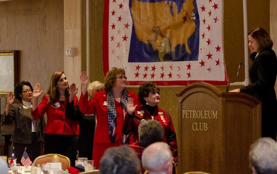 (File Photo) Judge Robin Darr administers the oath of office to the newly elected Midland County Republican Women's executive board Wednesday at the November luncheon. Tim Fischer\Reporter-Telegram Photo: Tim Fischer