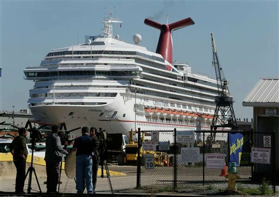 The cruise ship Carnival Triumph is moored at a dock in Mobile, Ala., Friday, Feb. 15, 2013. The ship, which docked Thursday in Mobile after drifting nearly powerless in the Gulf of Mexico for five days, was moved Friday from the cruise terminal to a repair facility. The ship carrying more than 4,200 passengers and crew members had been idled for nearly a week in the Gulf of Mexico following an engine room fire. (AP Photo/Dave Martin) Photo: Dave Martin / AP2013