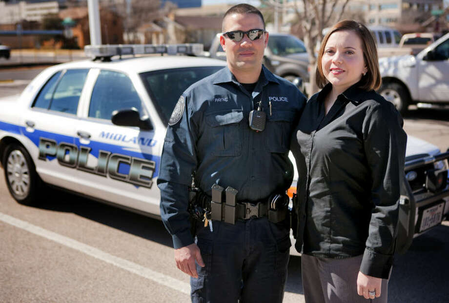 Allen and Marisa Payne pose for a portrait Wednesday outside the Midland Police Department. The Paynes met in 2001 while Allen was a rookie cop in the Ft. Worth Metroplex and Marisa was on a ride-along. They now serve together at the Midland Police Department. James Durbin/Reporter-Telegram Photo: JAMES DURBIN