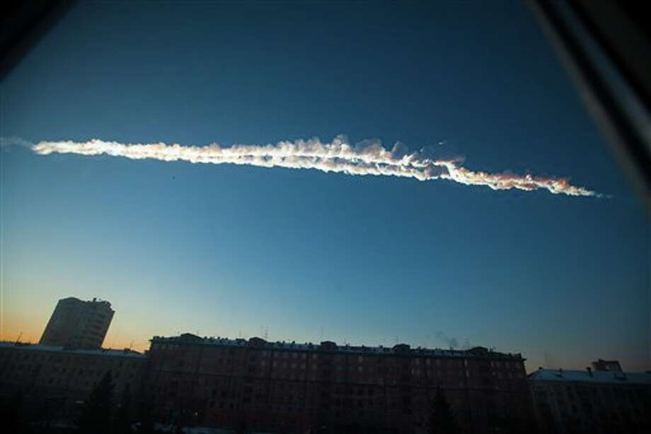 In this photo provided by Chelyabinsk.ru a meteorite contrail is seen over Chelyabinsk on Friday, Feb. 15, 2013. A meteor streaked across the sky of Russia's Ural Mountains on Friday morning, causing sharp explosions and reportedly injuring around 100 people, including many hurt by broken glass. (AP Photo/Chelyabinsk.ru) Photo: Yekaterina Pustynnikova / AP2013