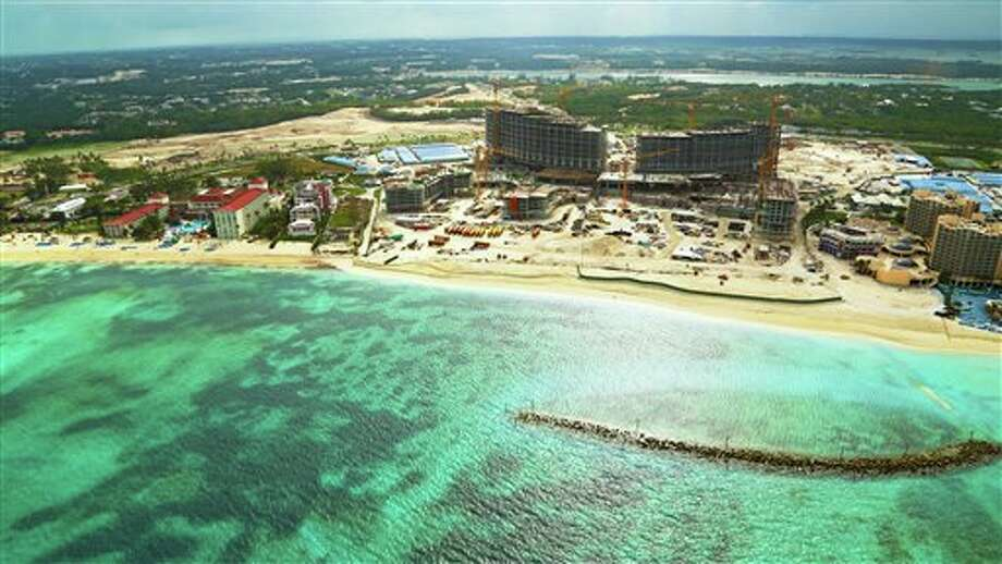 This Jan. 12, 2013 photo released by Baha Mar shows construction of the Baha Mar resort on the beach on New Providence island, Bahamas. For commercial projects such as the Bahamas resort, China is filling a gap left by western investors and bankers retrenching after the 2008 financial crisis. (AP Photo/Baha Mar, Jeong Ku Hwang) Photo: Jeong Ku Hwang / Baha Mar