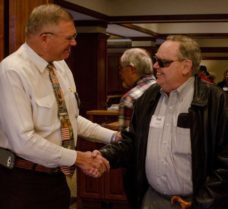 Sheriff Gary Painter talks with Tom Sloan Thursday before speaking at the John Birch Society luncheon at Midland Country Club. Tim Fischer\Reporter-Telegram Photo: Tim Fischer