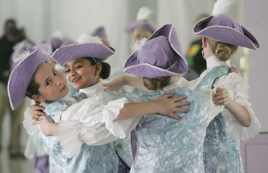 "Maria Lear, 11, from left, Julissa Carrasco, 12, Stockton Ashley, 11, and Rachel Paunell, 11, dance as they get things ready for Belle, Monday during rehearsals for ""Beauty and the Beast."" Photo: Cindeka Nealy"