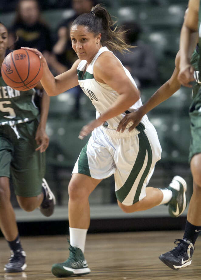 Midland College's Gabriela Martins runs the ball down the court against Western Texas Monday at Chaparral Center. James Durbin/Reporter-Telegram Photo: JAMES DURBIN