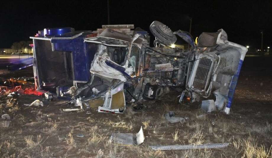 (File Photo) A tow truck used for towing trailers is in pieces after a fatal rollover crash Tuesday night on Farm-to-Market Road 1788. Tyler White/Reporter-Telegram Photo: TYLER WHITE