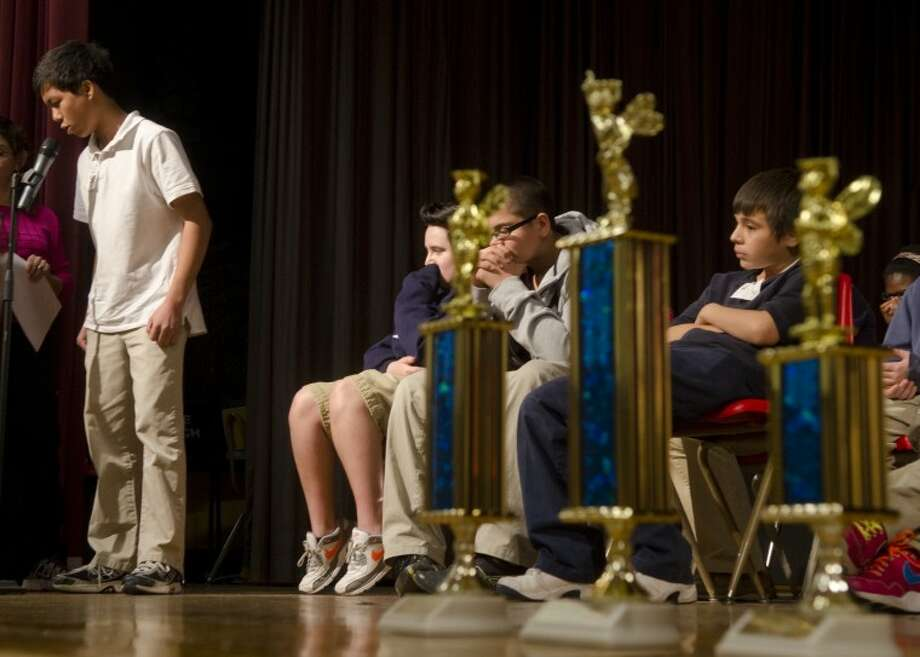 Alamo Junior High student Thomas Rubio and other students compete in the school spelling bee at Alamo in January. Photo by Tim Fischer/Midland Reporter-Telegram Photo: Tim Fischer