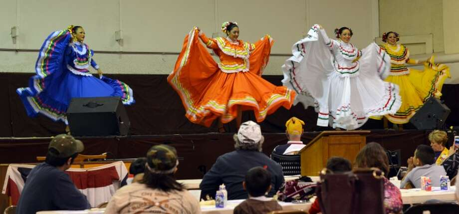 Ballet Folklorico dancers entrain the diners Saturday afternoon the Midland Downtown Lions Club's 55th annual Pancake Jamboree. The dancers, aged 5 to 18 years old, perform traditional Mexican Folk dancing in colorful garb. Photo: James Cannon/MRT