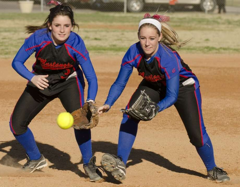 Bethany, left and her sister Lindzey Roach, Midland Christian players battle for a ball before a game Friday. Photo by Tim Fischer/Midland Reporter-Telegram Photo: Tim Fischer