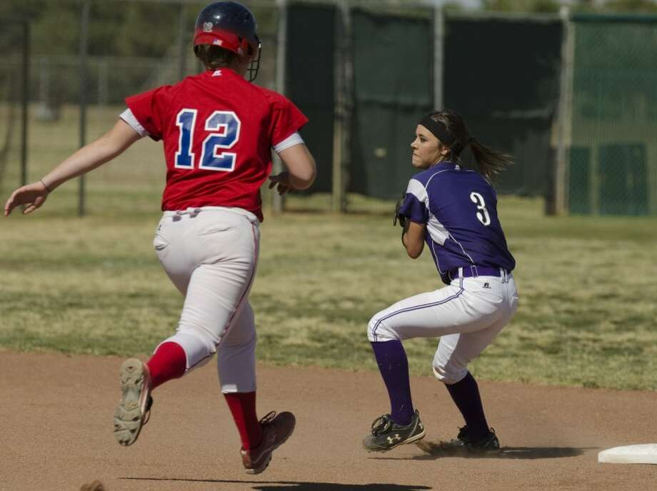 Midland High's Taylor Vines makes the throw to first to complete the double play after tagging Abilene Cooper's McKenzie Blair out at second Tuesday afternoon. Photo by Tim Fischer/Midland Reporter-Telegram Photo: Tim Fischer