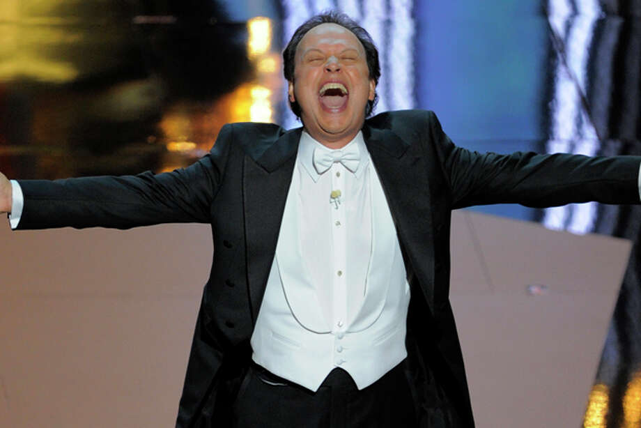 Billy Crystal performs during the 84th Academy Awards on Sunday, Feb. 26, 2012, in the Hollywood section of Los Angeles. (AP Photo/Mark J. Terrill) Photo: Mark J. Terrill / Copyright 2012 The Associated Press. All rights reserved. This material may not be published, broadcast, rewritten or redistributed.