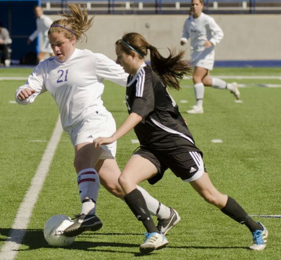 Midland High's Morgan Hannon tries to keep the ball away from Permian's Emily Morris Saturday at Grande Communication Stadium. Photo by Tim Fischer/Midland Reporter-Telegram Photo: Tim Fischer