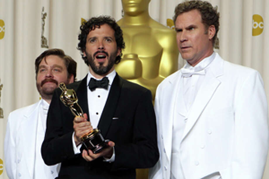 """Bret McKenzie poses with his Oscar for best original song for his work in """"Man or Muppet"""" as he stands with Nick Offerman, left, and Will Farrell during the 84th Academy Awards on Sunday, Feb. 26, 2012, in the Hollywood section of Los Angeles. (AP Photo/Joel Ryan) Photo: Joel Ryan / AP"""