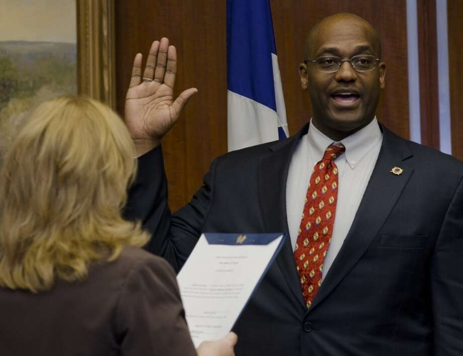 John Love III takes his oath of office Monday as city secretary Amy Turner administers the oath to new and returning council members. Tim Fischer\Reporter-Telegram Photo: Tim Fischer