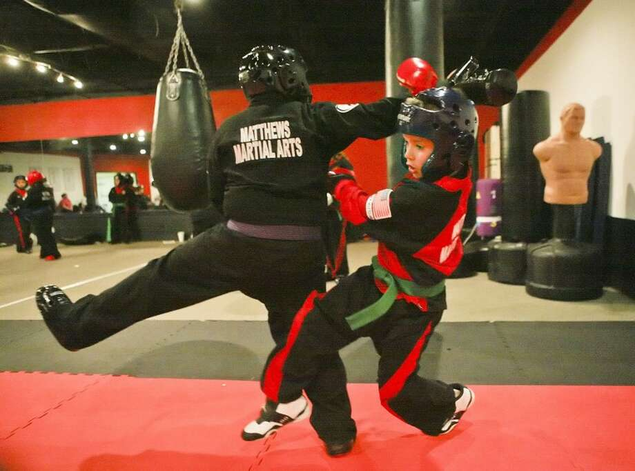 Mason Murdock, 9, left, and Diego Lozano, 10, point spar Feb. 22, at Matthews Martial Arts Karate Studio. During a point sparing match each student is trying to break down or pick apart their opponent with technique. Cindeka Nealy/Reporter-Telegram Photo: Cindeka Nealy