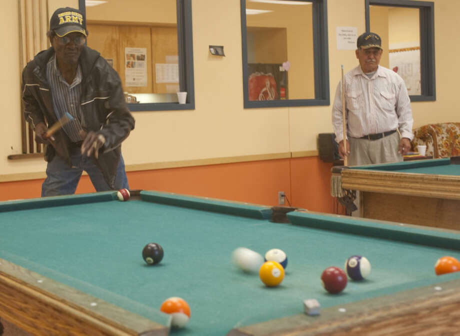 Johnny Douglas Sr. watches his shot Wednesday during a game of pool at the Southeast Senior Center. Tim Fischer\Reporter-Telegram Photo: Tim Fischer