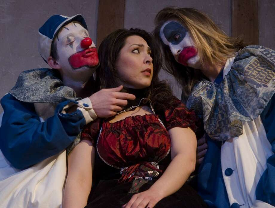 Tom Laney as Taddeo, left, and Christopher Brokaw as Tonio try to entice Gabrielle Enriquez as Nedda during the Globe Theater's production of Pagliacci. Photo by Tim Fischer/Midland Reporter-Telegram Photo: Tim Fischer
