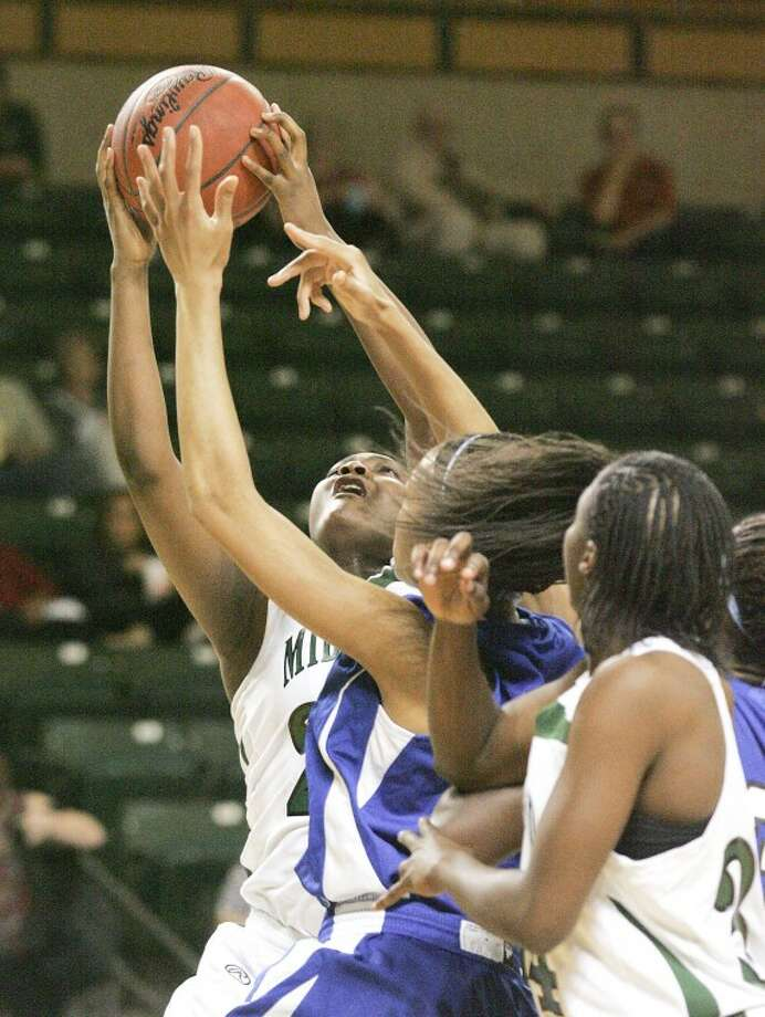 Midland College's Alexis Kelley (23) takes the shot for two as she's guarded by Odessa College's Caroline Adesulu (40) Thursday during their game at the Chaparral Center. Cindeka Nealy/Reporter-Telegram Photo: Cindeka Nealy