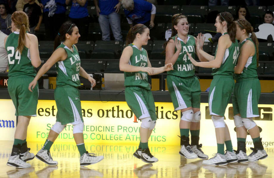 The Wall girls basketball team reacts after beating Childress in the UIL Region 1-AA Girls Basketball Semi-Final Friday at Chaparral Center. The Wall Lady Hawks beat the Childress Lady Cats 38-30. James Durbin/Reporter-Telegram Photo: JAMES DURBIN