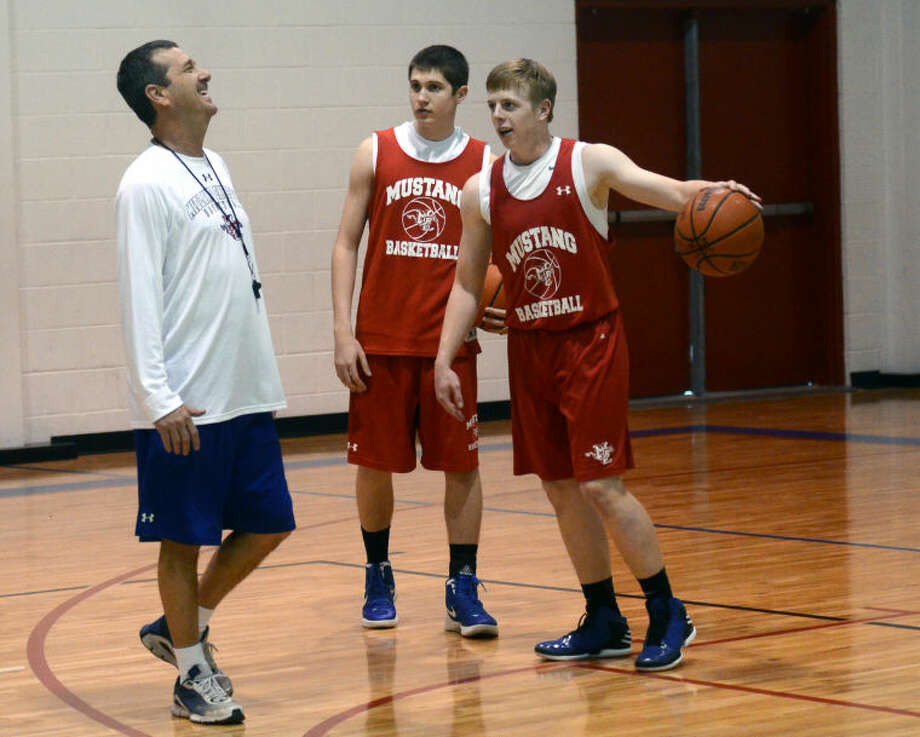 Midland Christian head coach Marks Lanham jokes with guards Zach Gilbert and Mason McClendon during team practice Thursday at the Midland Christian gym. James Durbin/Reporter-Telegram Photo: JAMES DURBIN