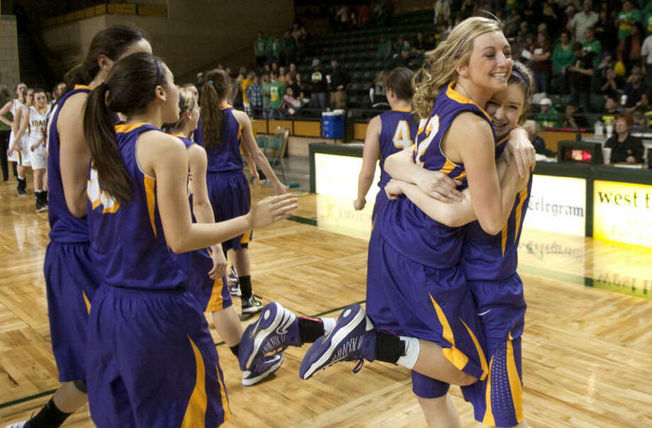 Merkel's Ciara Cope and Macy Mays embrace while the team celebrates a win against Idalou during the UIL Region 1-AA Girls Basketball Semi-Final Friday at Chaparral Center. James Durbin/Reporter-Telegram Photo: JAMES DURBIN