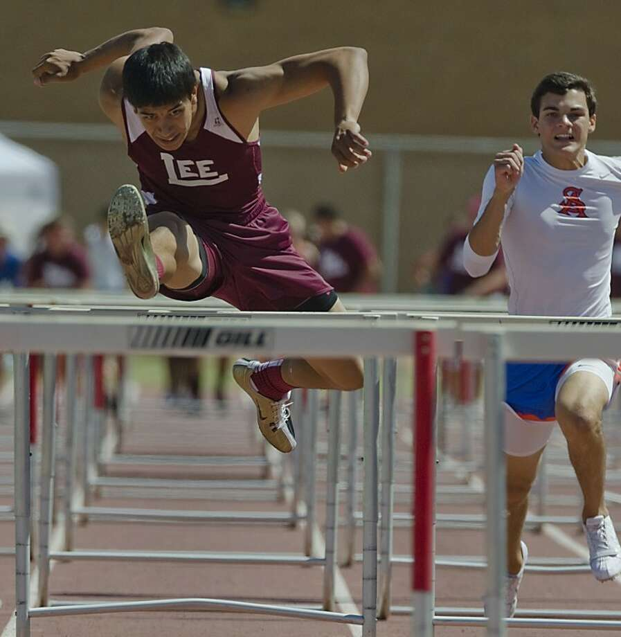 """The body position just reminded me of a bird flying over the hurdles as Talor Nunez wins his heat of high hurdles.""- Tim FisherMidland Lee's Talor Nunez wins the boys 110 meter hurdles Friday as he beats San Angelo's Ryan Bahlman and the rest of the field Friday at the 3-AAAAA district meet at Memorial Stadium. Photo by Tim Fischer/Midland Reporter-Telegram Photo: Tim Fischer"