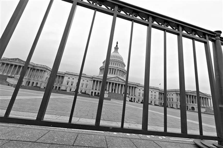 The Capitol plaza is seen as automatic spending cuts are set to take effect on March 1, in Washington, Tuesday, Feb. 26, 2013. (AP Photo/J. Scott Applewhite) Photo: J. Scott Applewhite / AP