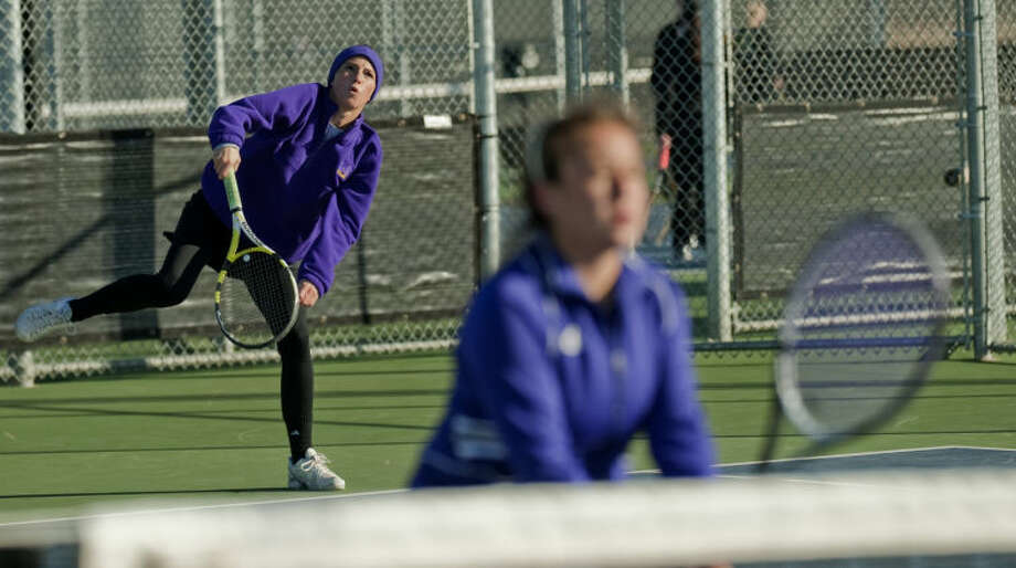 Midland High's Morgan Kratzer serves as doubes partner Adriana Garcia waits for a return at the net Friday during a match ar the Tall City Classic at the Bush Tennis Center. Tim Fischer\Reporter-Telegram Photo: Tim Fischer