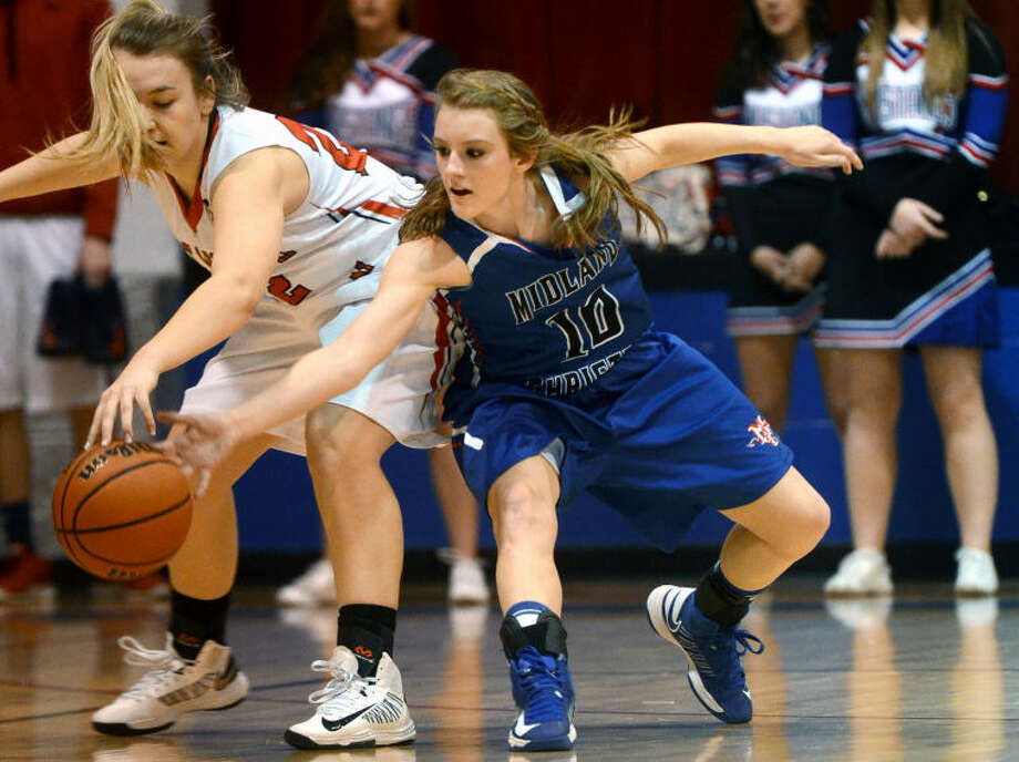 Midland Christian's Morgan Ashton fights against Arlington Grace Prep's Jeri Shap to recover a loose ball Saturday at the McGraw Special Events Center at MCS. James Durbin/Reporter-Telegram Photo: JAMES DURBIN