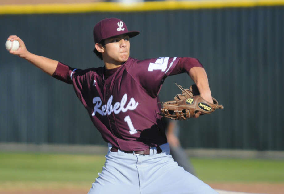 Midland Lee's Evan Mata pitches in the first inning of a District 2-5A baseball game against Odessa High on Tuesday at Odessa High's Pressly Field. (Odessa American photo)