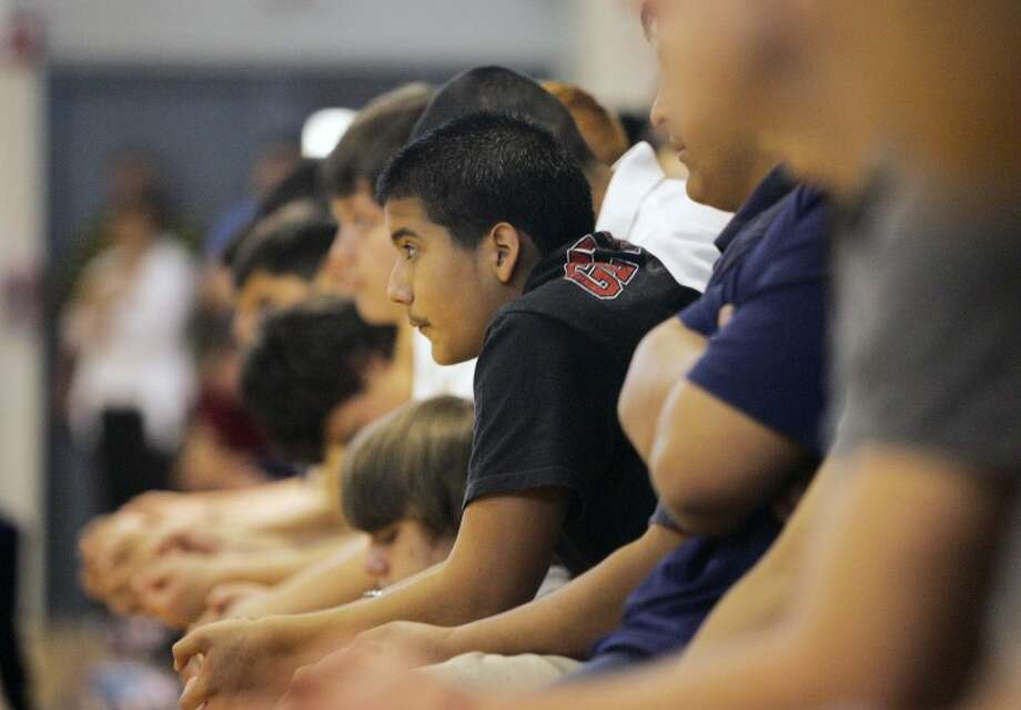 Tristan Saenz, 14, listens as Dave Roever shares the story about the day a hand grenade he was poised to throw, exploded in his hand and burned him beyond recognition Monday Lee Freshman High School. Cindeka Nealy/Reporter-Telegram Photo: Cindeka Nealy