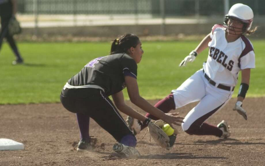 Lee High's Alicia Alvarez safely steals second as Midland High's Naomi Posada can't make the tag in time last season at LHS. Photo by Tim Fischer/Midland Reporter-Telegram Photo: Tim Fischer