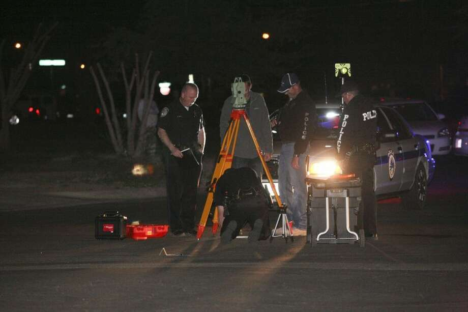 Midland Police Department crime scene investigators and detectives investigate the scene of a shooting Monday night. Stephen Gowan, 39, died from his injuries. The shooting occurred near the intersection of Nobles Avenue and Pecos Street. Photo: Cindeka Nealy/Reporter-Telegram
