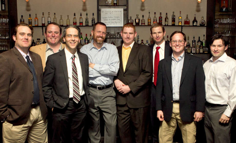 TallTownes Entertainment members from left, Nate Brignon, Andy Chandler, Darren Skyles, Matt Catalano, Zac Brandl, Dvaid Stroman, Michael Blonkrist and Jason South pose for a picture at the TallTownes Entertainment happy hour sponsored by the Blue Door on Wednesday. The group gave away two tickets to the Bob Schneider concert happening Friday at the Yucca Theater. James Durbin/Reporter-Telegram Photo: JAMES DURBIN