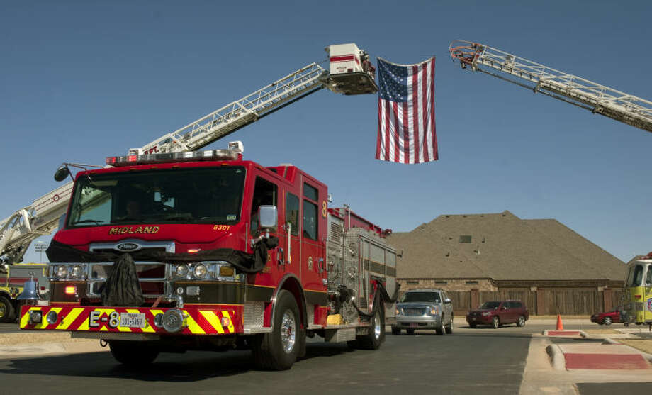 Midland fire departments Engine 8, draped with black cloths, escort the remains of MFD Capt. Lee Wise to the memorial service Thursday afternon at Stonegate Fellowship Church. Tim Fischer\Reporter-Telegram Photo: Tim Fischer