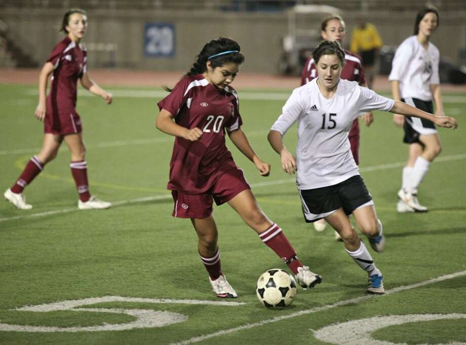 Midland Lee's Abby Ramirez battles with Permian's Emily Morris during Tuesday night's game at Ratliff Stadium in Odessa. Photo: Heather Leiphart/Odessa American