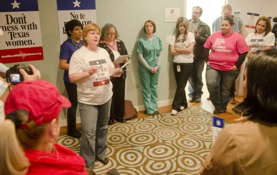 """(FILE PHOTO) Karen Hildebrand, CEO of Planned Parenthood of West Texas, speaks Thursday at the """"Don't Mess with Texas Women"""" rally at Planned Parenthood to protest the cuts in women's health care coverage. Photo: Tim Fischer/Reporter-Telegram"""