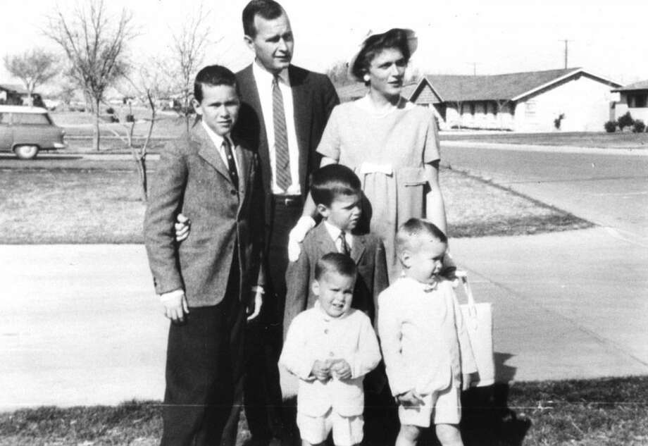 George W. poses with his family in this 1959 photo, our earliest photo of the future president during his youth in Midland. Also pictured, top row: father George H.W. Bush, and mother Barbara (who was pregnant with sister W.'s sister Dorothy at the time). In front, siblings Jeb, Neil and Marvin.