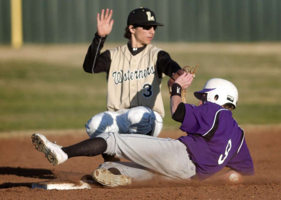 Midland High's JM Hillman slides safely into second base in front of Lubbock High's Keenan Phillips during the Tournament of Champions on Thursday at Zachary Field. James Durbin/Reporter-Telegram Photo: JAMES DURBIN