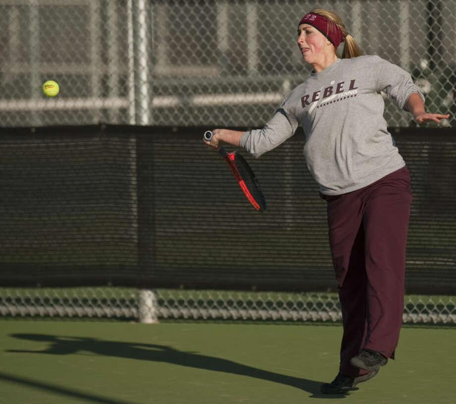 Lee High's Hope Williams returns a shot Friday during a match ar the Tall City Classic at the Bush Tennis Center. Tim Fischer\Reporter-Telegram Photo: Tim Fischer