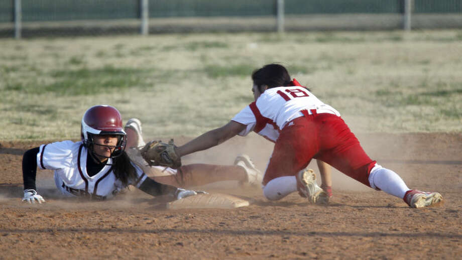 Lee's Adriana Berzoza evades a tag from Odessa's Jasmine Alvarez and slides safely into second base during the West Texas Classic Friday at Freddie Ezell Softball Complex. James Durbin/Reporter-Telegram Photo: JAMES DURBIN