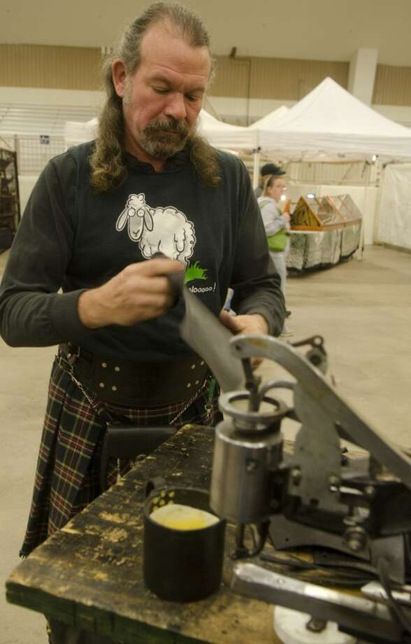 Rev Gurski works on a piece of leather in his booth, Rev's Armour Werx, Satrurday at the Scottish Irish Fair. Photo by Tim Fischer/Midland Reporter-Telegram Photo: Tim Fischer