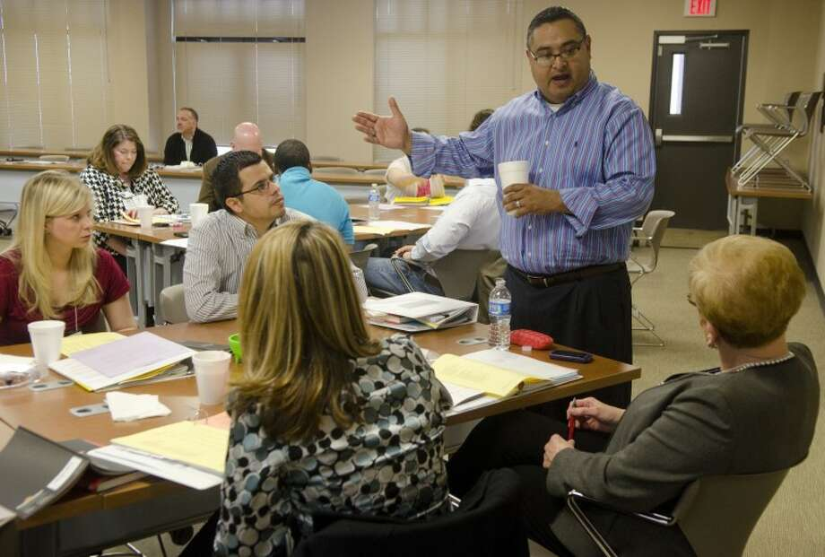 Paul Acosta, associate director of Non-Profit Management Center, talks with one of the small groups Tuesday at a Generations training program. Photo by Tim Fischer/Midland Reporter-Telegram Photo: Tim Fischer