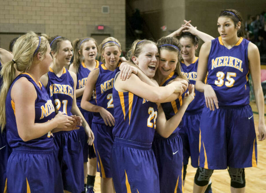 The Merkel girls basketball team celebrates after beating Wall in the 2013 UIL Region 1-AA Girls Basketball Final Saturday at Chaparral Center. The Merkel Lady Badgers beat the Wall Lady Hawks 48-30. James Durbin/Reporter-Telegram Photo: JAMES DURBIN