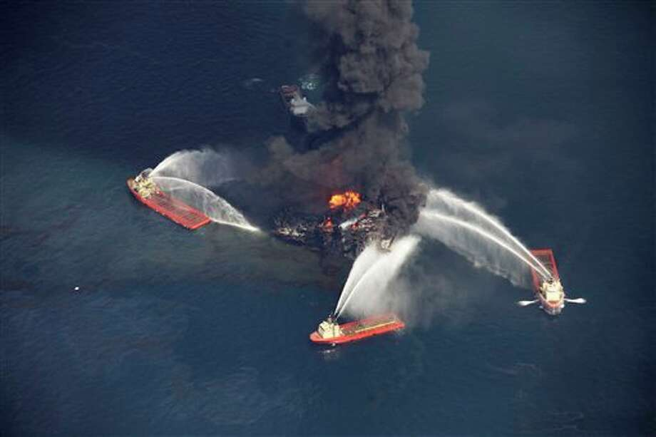 FILE - In this aerial file photo madeWednesday, April 21, 2010 in the Gulf of Mexico, more than 50 miles southeast of Venice on Louisiana's tip, an oil slick is seen as the Deepwater Horizon oil rig burns. Nearly three years after the deadly rig explosion in the Gulf of Mexico triggered the nation's worst offshore oil spill, a federal judge in New Orleans is set to preside over a high-stakes trial for the raft of litigation spawned by the disaster on Monday Feb. 25, 2013. (AP Photo/Gerald Herbert, file) Photo: Gerald Herbert / AP