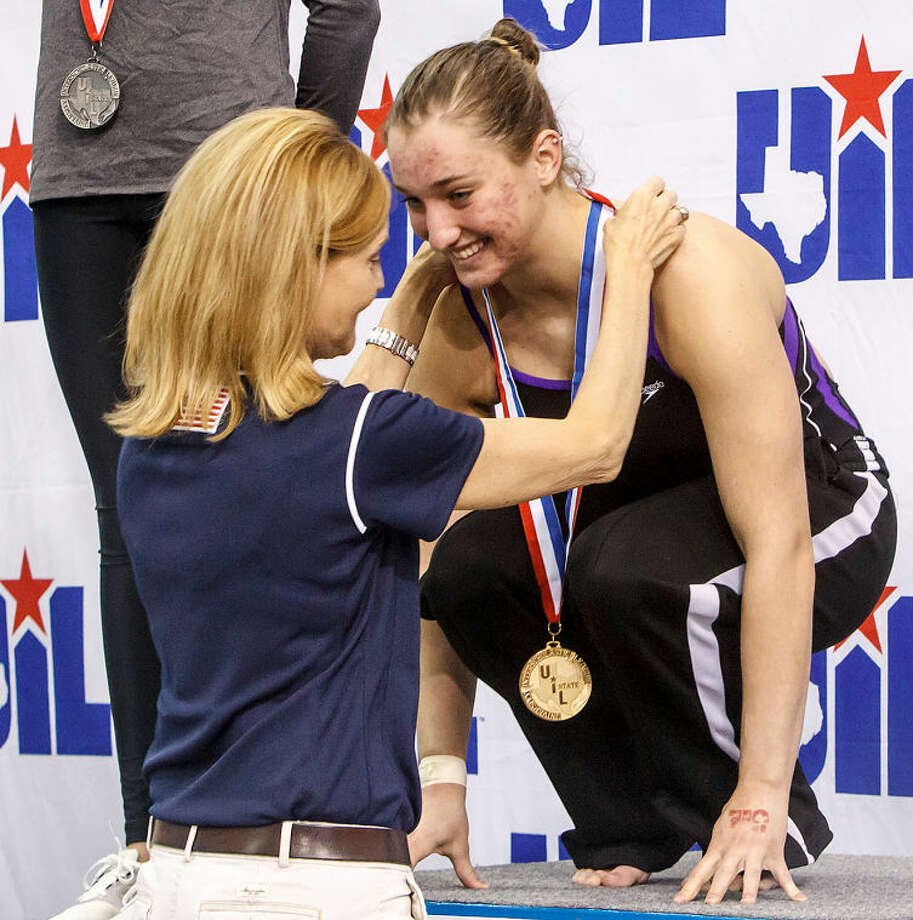Midland's Anna James receives her gold medal for girls 1 meter diving in the finals of the 5A UIL Swimming & Diving State Meet at the Jamail Texas Swim Center in Austin on Saturday, Feb 23, 2013. MARVIN PFEIFFER/ mpfeiffer@express-news.net Photo: MARVIN PFEIFFER