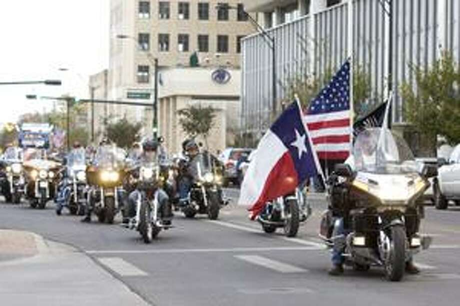 (File Photo) Members of the Patriot Guard Riders ride behind the color guard in a parade for the Show of Support Hunt for Heroes honorees downtown Thursday evening.photo by Gary Rhodes 11/19/09 Photo: Gary Allred Rhodes II