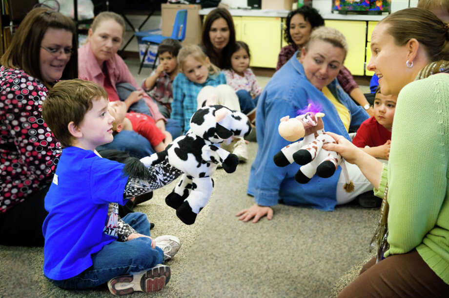 Carissa Hamilton, right, teaches children during a First Steps in Music class last year. Photo: Cliff Hamilton