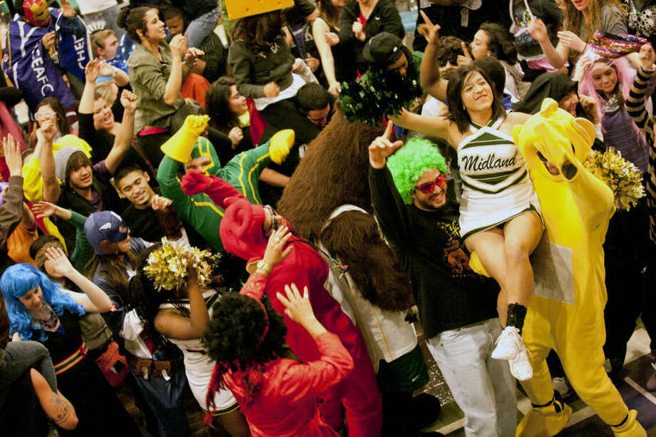 "Midland College students participate in a filming of the Harlem Shake Friday in the student center at Midland College. The Harlem Shake is an internet video sensation that went viral in February 2013 where one person (often helmeted or masked) dances to an excerpt from the song ""Harlem Shake"" alone for 15 seconds, surrounded by other people unaware of the dancing individual. When the bass drops, the video cuts to the entire crowd (usually wearing a variety of costumes) doing a crazy convulsive dance for the next 15 seconds. James Durbin/Reporter-Telegram Photo: JAMES DURBIN"
