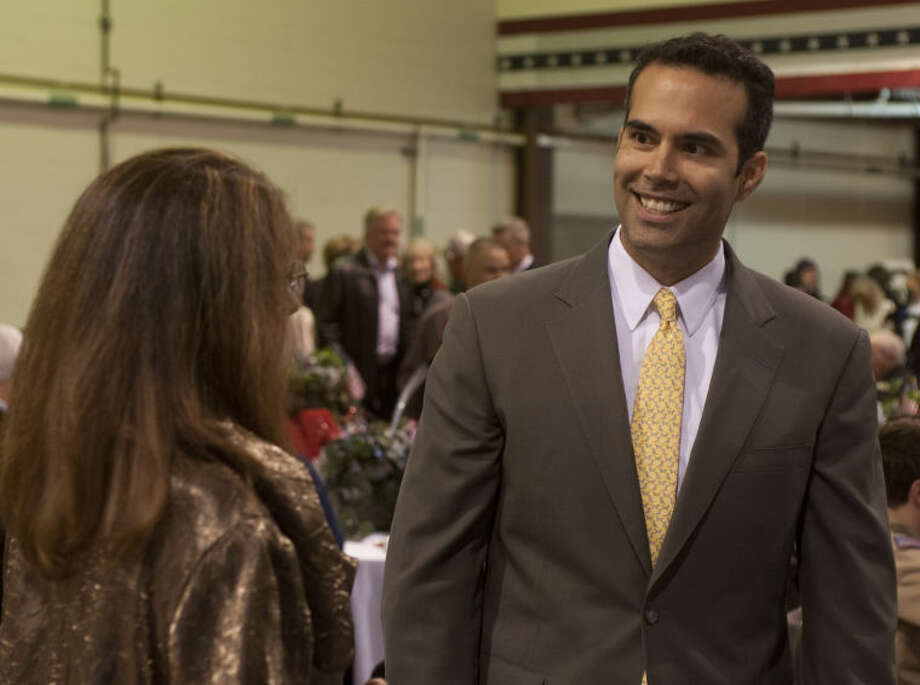 George P. Bush speaks with Suzanne Conaway Monday evening at a Bush Day Dinner with the Midland and Odessa Republican Parties. Tim Fischer\Reporter-Telegram Photo: Tim Fischer